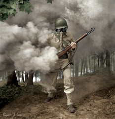Sergeant George Camblair Practicing With His Gas Mask In A Smokescreen. Fort Belvoir, Virginia, 1942