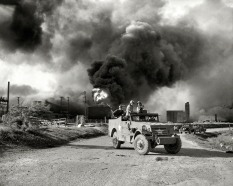 Armed troops block off a road near an explosion at an oil factory near Texas City, Texas. April 17, 1947. (original from shorpy.com)