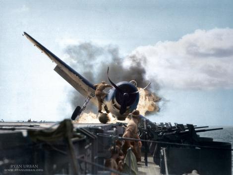 Lieutenant Walter L. Chewning, Jr. climbs aboard a crashed Hellcat to save pilot, Ensign Byron M. Johnson. USS Enterprise, November 10th, 1943.