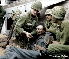 Allied Soldiers Giving Water to Wounded German, WWII
